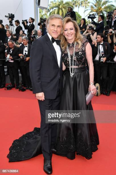 Christoph Waltz and Caroline Scheufele attend the 70th Anniversary screening during the 70th annual Cannes Film Festival in Cannes France on May 23...