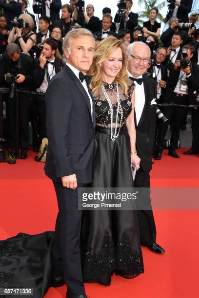 Christoph Waltz Caroline Scheufele and guest attend the 70th Anniversary screening during the 70th annual Cannes Film Festival at Palais des...