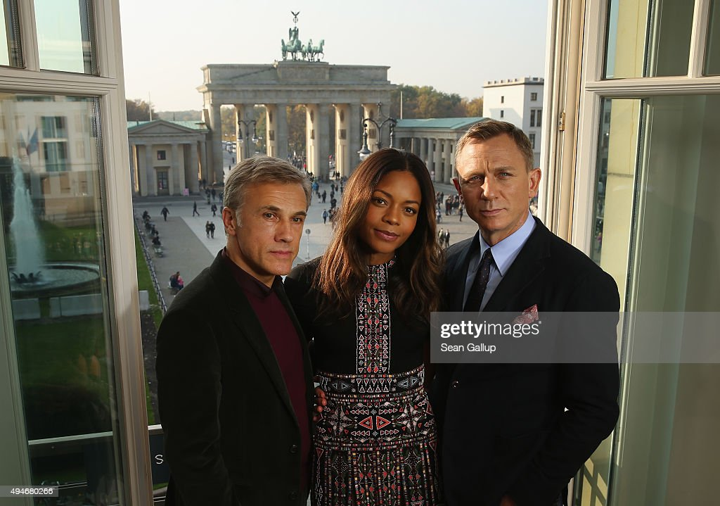 Christoph Waltz Naomie Harris and Daniel Craig pose with the Brandenburg Gate behind during a photocall prior the German premiere of the new James...