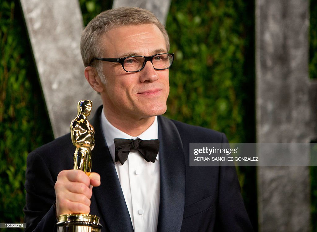 Christoph Waltz poses with his Oscar for best supporting actor after arriving for the 2013 Vanity Fair Oscar Party on February 24, 2013 in Hollywood, California.