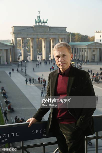 Christoph Waltz stands with the Brandenburg Gate behind during a photocall prior the German premiere of the new James Bond movie 'Spectre' at Hotel...