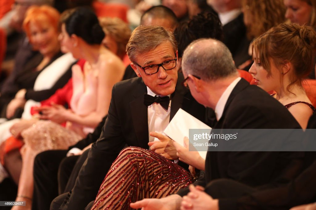 Christoph Waltz talks to James Schmus during the closing ceremony during 64th Berlinale International Film Festival at Berlinale Palast on February...