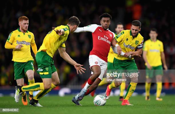 Christoph Zimmermann of Norwich City and Ivo Pinto of Norwich City try to stop Alex Iwobi of Arsenal during the Carabao Cup Fourth Round match...