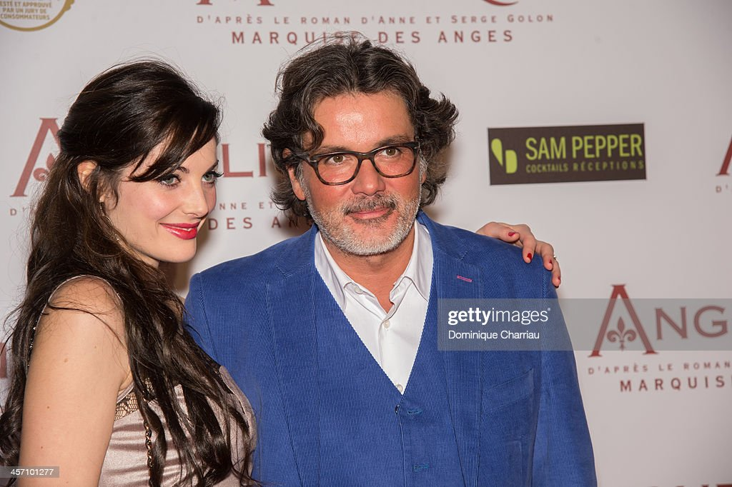 Christophe Barratier and guest attend the 'Angelique' Paris Premiere at Gaumont Capucines Cinema on December 16 2013 in Paris France