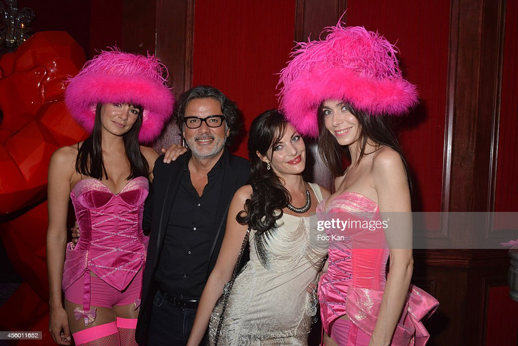 Christophe Barratier Gwendoline Doycheva and dancers attend the New Pink Paradise Club Opening Party on September 23 2014 in Paris France