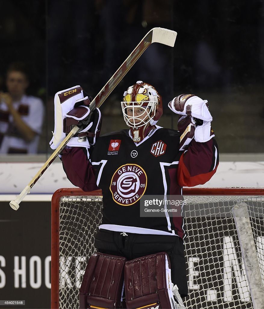 Christophe Bays of Geneve-Servette celebrates at the end of the game of the Champions Hockey League group stage game between Geneve-Servette and Villach SV on August 23, 2014 in Geneva, Switzerland.