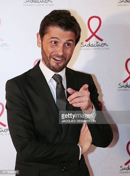Christophe Beaugrand host on the French TV channel NT1 gestures as he arrives for the Sidaction 2014 launch at the Musee du Quai Branly in Paris AFP...