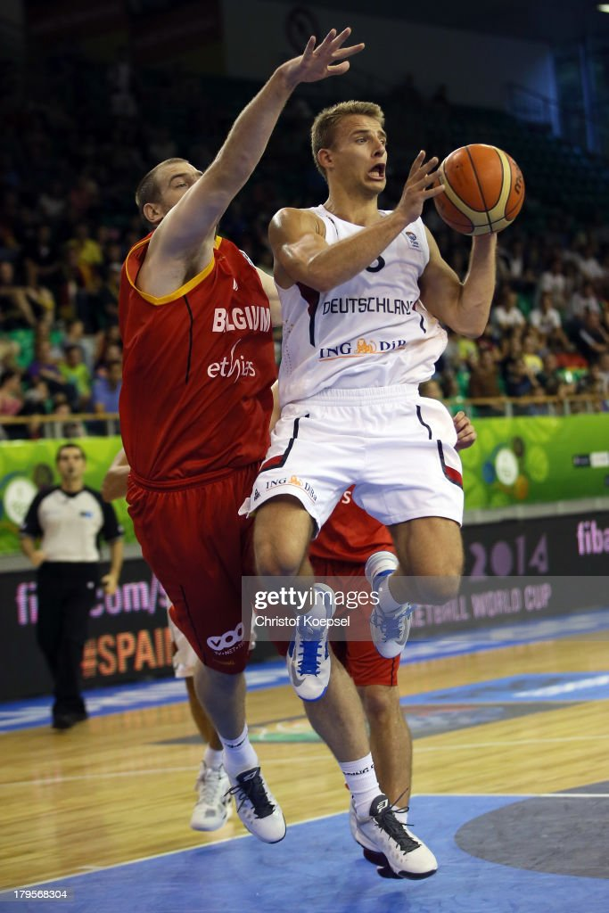 Christophe Berghin of Belgium defends against Heiko Schaffartzik of Gemany during the FIBA European Championships 2013 first round group A match between Germany and Belgium at Tivoli Arena on September 5, 2013 in Ljubljana, Slovenia.
