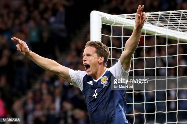 Christophe Berra of Scotland celebrates as he scores their first goal during the FIFA 2018 World Cup Qualifier between Scotland and Malta at Hampden...