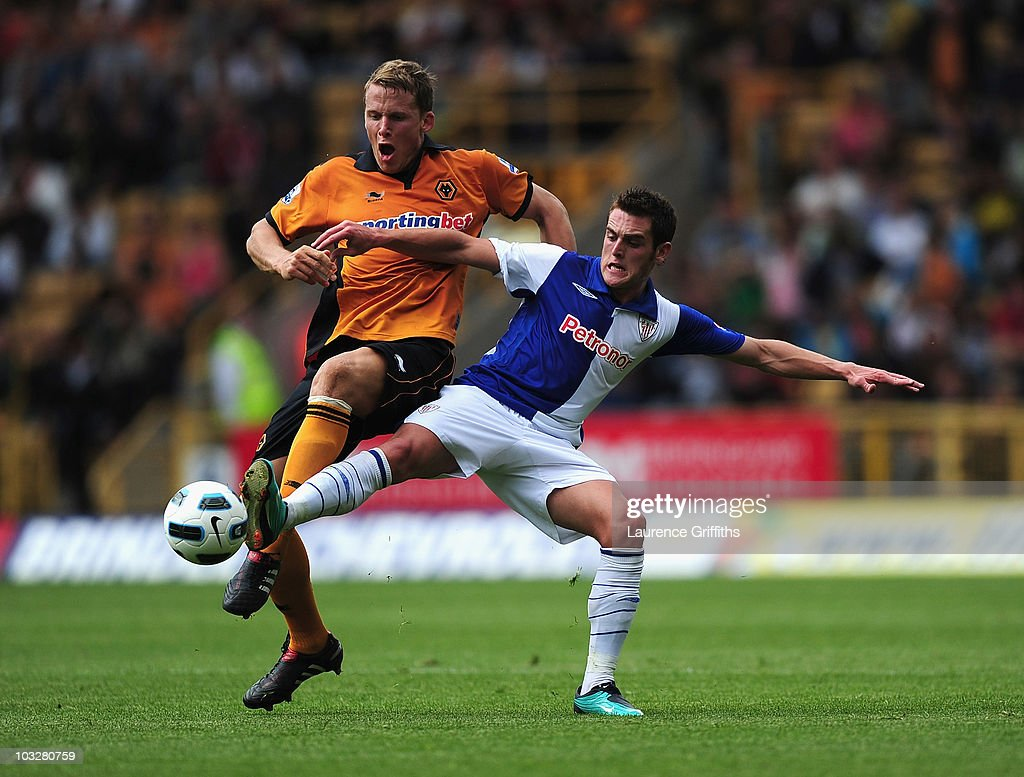 Christophe Berra of Wolverhampton Wanderers battles for the ball with Ibai Gomez of Atletico Bilbao during the Pre Season Friendly match between Wolverhampton Wanderers and Atletico Blbao at Molineux on August 7, 2010 in Wolverhampton, England.