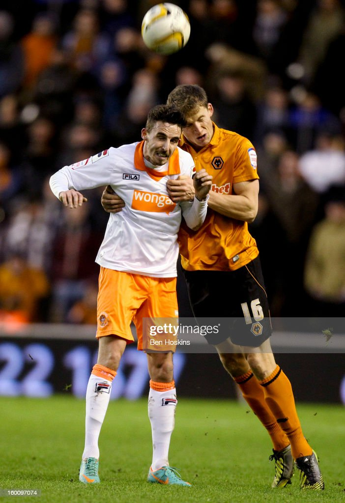 Christophe Berra of Wolves battles with Matt Derbyshire of Blackpool during the npower Championship match between Wolverhampton Wanderers and Blackpool at Molineux on January 24, 2013 in Wolverhampton, England.