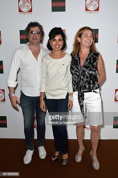 Christophe Bonnat Rachida Dati and Coco Couperie Eiffel attend the Paris Eiffel Jumping presented by Gucci at ChampdeMars on July 4 2014 in Paris...