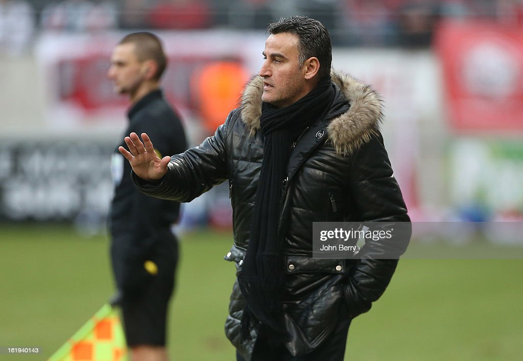 Christophe Galtier, coach of ASSE looks on during the french Ligue 1 match between Stade de Reims and AS Saint-Etienne at the Stade Auguste Delaune on February 17, 2013 in Reims, France.