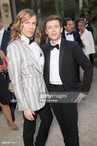 Christophe Guillarme and a guest arrive for the amfAR Paris Dinner at Le Petit Palais on July 2 2017 in Paris France