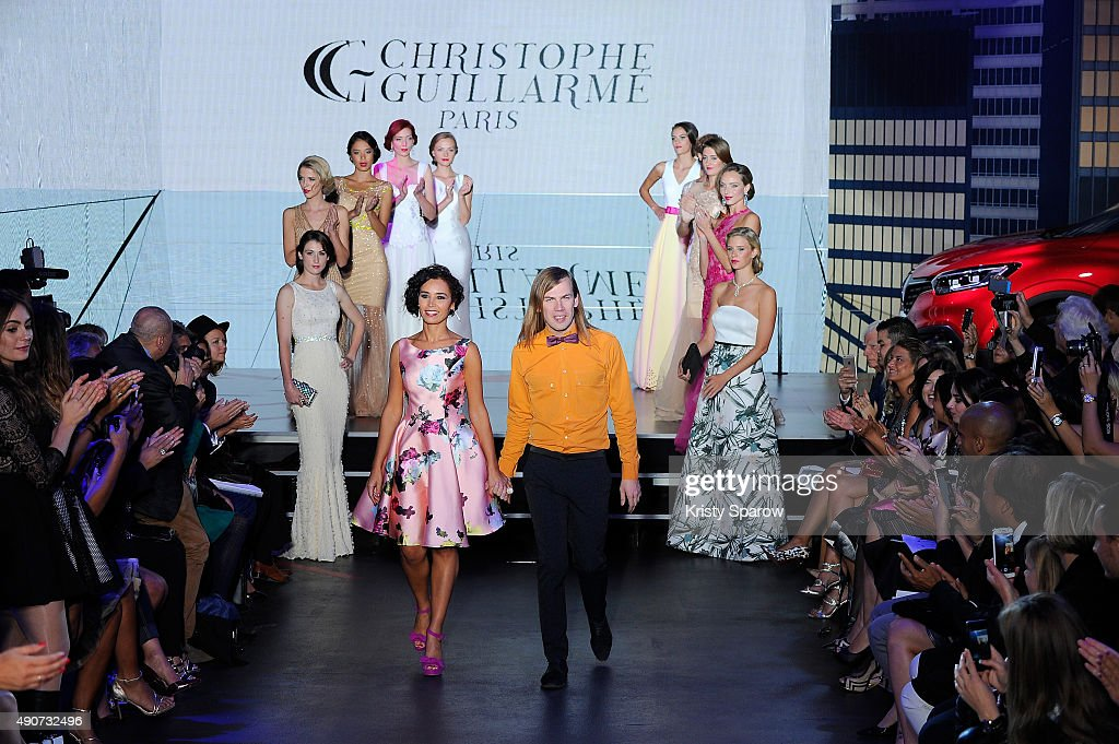 Christophe Guillarme and Aida Touihri acknowledge the audience during the finale of the Christophe Guillarme show as part of Paris Fashion Week...