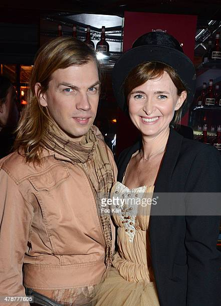 Christophe Guillarme and Annabelle Milot attend 'La Parisienne' Annabelle Milot And Marc Fichel Show Case at the Grand Marnier House Ephemeral Bar of...