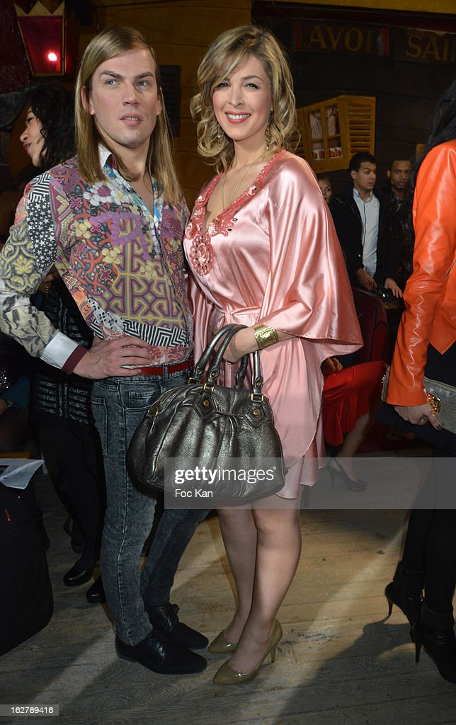 Christophe Guillarme (L) and Eleonore Boccara attend the Christophe Guillarme Fall/Winter 2013 Ready-to-Wear show as part of Paris Fashion Week on February 26, 2013 in Paris, France.