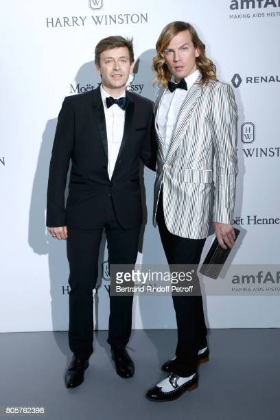 Christophe Guillarme and guest attend the amfAR Paris Dinner 2017 at Le Petit Palais on July 2 2017 in Paris France