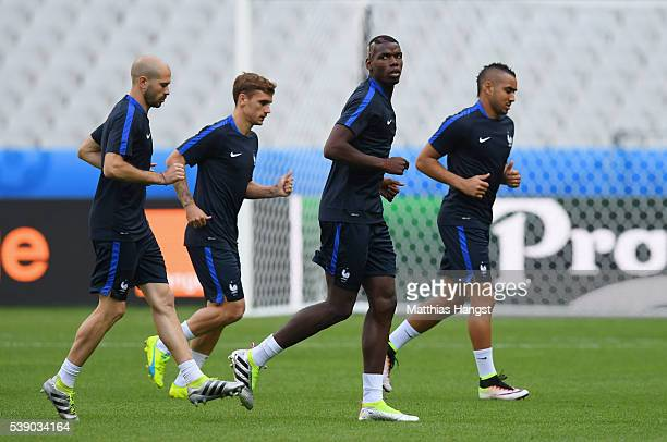 Christophe Jallet Antoine Griezmann Paul Pogba and Dimitri Payet of France warm up during training session ahead of the UEFA EURO 2016 Group A match...
