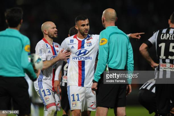 Christophe Jallet of Lyon and Rachid Ghezzal of Lyon and referee Antony Gautier during the French Ligue 1 match between Angers and Lyon on April 28...