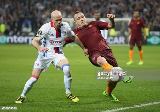 Christophe Jallet of Lyon and Radja Nainggolan of AS Roma in action during the UEFA Europa League Round of 16 first leg match between Olympique...