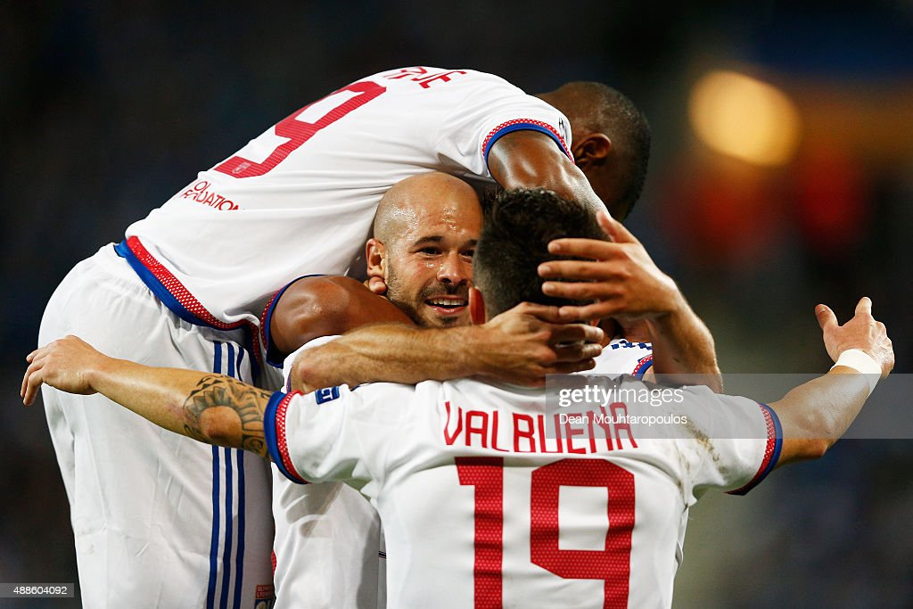 Christophe Jallet of Lyon celebrates scoring his teams first goal of the game with team mates during the UEFA Champions League Group H match between...