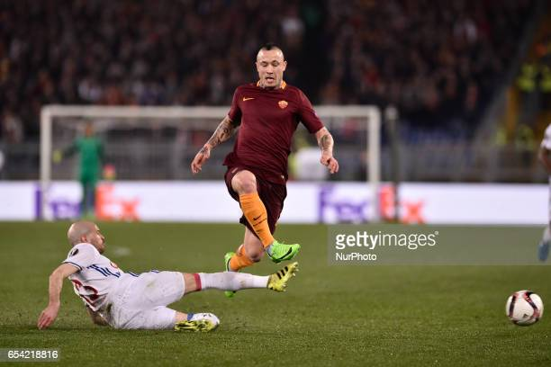Christophe Jallet of Olympique Lyonnais challenges Radja Nainggolan of AS Roma during the UEFA Europa League match between Roma and Olympique...