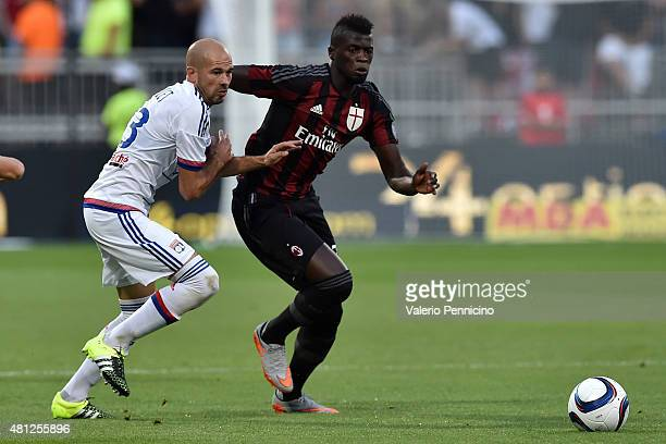 Christophe Jallet of Olympique Lyonnais competes with Mbaye Niang of AC Milan during the preseason friendly match between Olympique Lyonnais and AC...