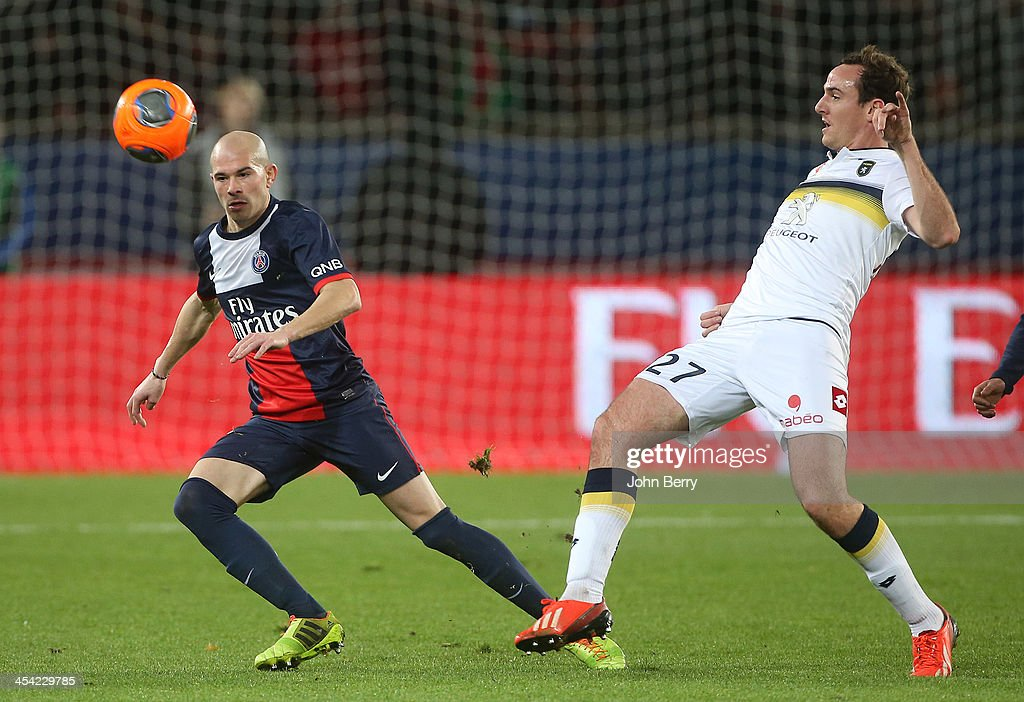 <a gi-track='captionPersonalityLinkClicked' href=/galleries/search?phrase=Christophe+Jallet&family=editorial&specificpeople=2264495 ng-click='$event.stopPropagation()'>Christophe Jallet</a> of PSG and Loic Poujol of Sochaux in action during the french Ligue 1 match between Paris Saint-Germain FC and FC Sochaux Montbeliard at the Parc des Princes stadium on December 7, 2013 in Paris, France.