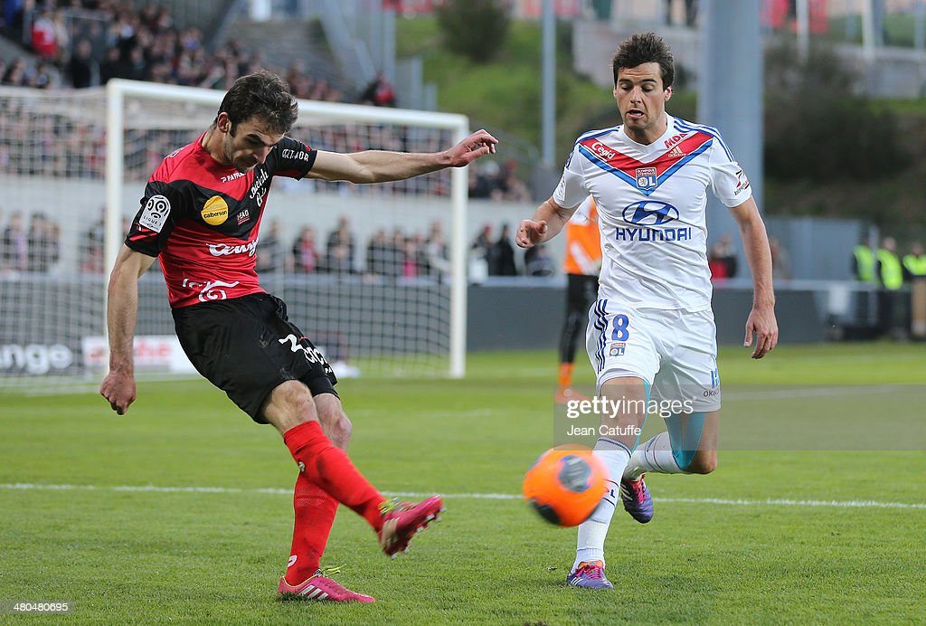 Christophe Kerbrat of Guingamp and <a gi-track='captionPersonalityLinkClicked' href=/galleries/search?phrase=Yoann+Gourcuff&family=editorial&specificpeople=600434 ng-click='$event.stopPropagation()'>Yoann Gourcuff</a> of Lyon in action during the french Ligue 1 match between EA Guingamp FC and Olympique Lyonnais OL at Stade de Roudourou on March 23, 2014 in Guingamp, France.