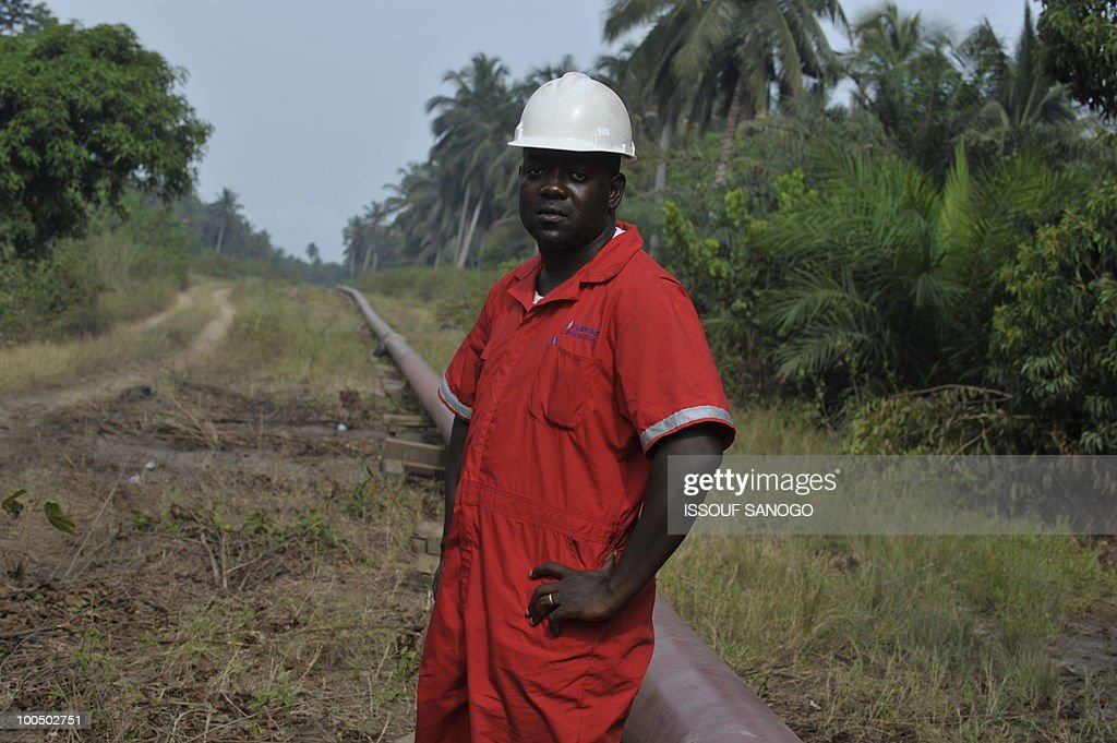 Christophe KOFFI A worker stands beside an under construction petrol pipeline in Jacqueville some 50 Kms west of Abidjan on May 6, 2010. Inhabitants of the region through which the pipleline is passing feel that although it passes through their lands, they have been excluded from sharing in the proffits it brings.