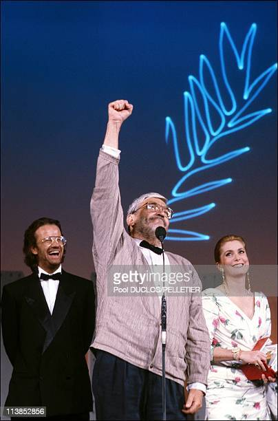 Christophe Lambert and Catherine Deneuve with director Maurice Pialat who receives the golden palm for the film 'Under the sun of Satan at Cannes...