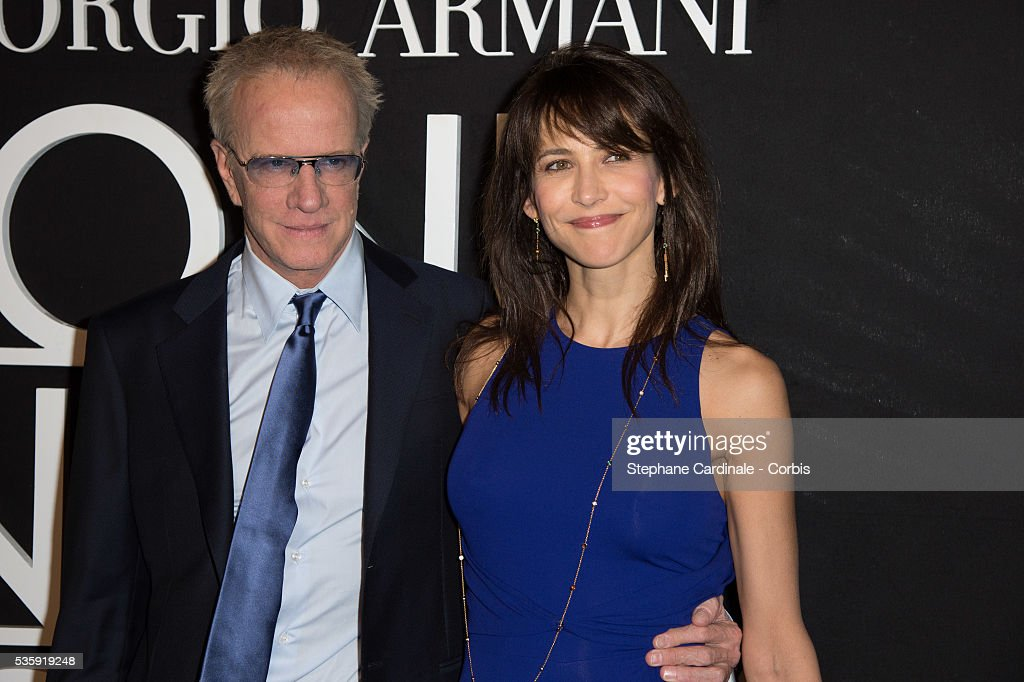 Christophe Lambert and Sophie Marceau attend the Giorgio Armani Prive show as part of Paris Fashion Week Haute Couture Spring/Summer 2014, at Palais de tokyo in Paris.