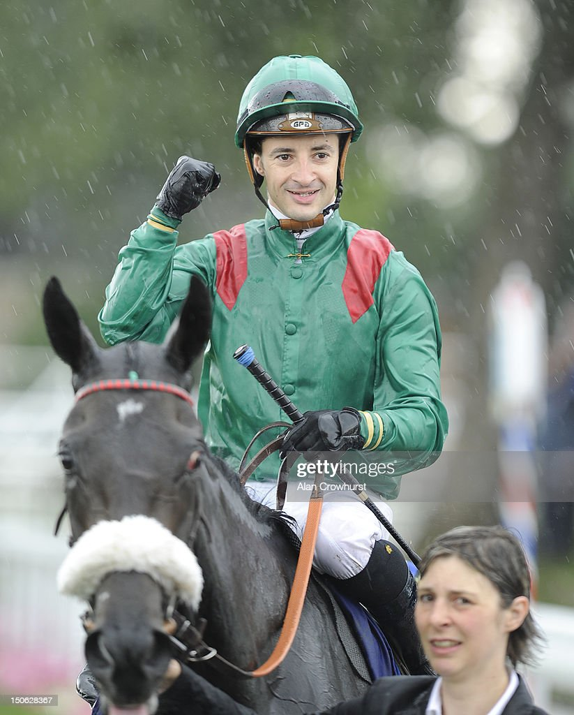 Christophe Lemaire celebrates riding Shareta after winning The Darley Yorkshire Oaks at York racecourse on August 23, 2012 in York, England.