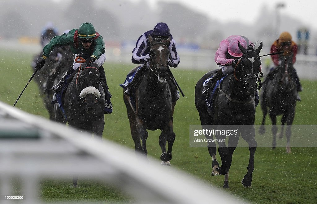 Christophe Lemaire riding Shareta (L) win The Darley Yorkshire Oaks at York racecourse on August 23, 2012 in York, England.