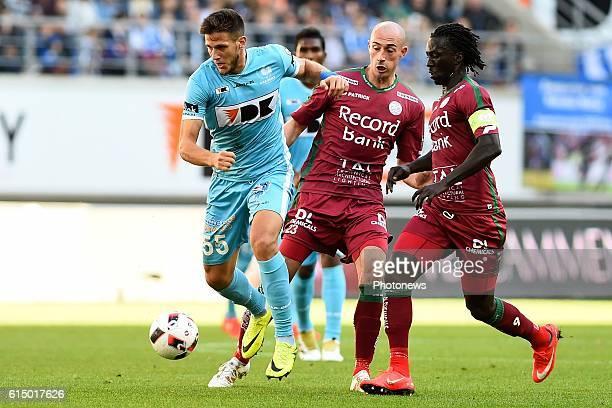 Christophe Lepoint midfielder of SV Zulte Waregem Mbaye Leye forward of SV Zulte Waregem and Rami Gershon defender of KAA Gent during the Jupiler Pro...