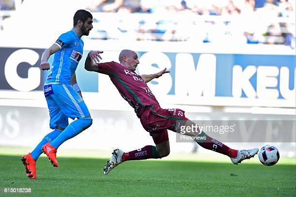 Christophe Lepoint midfielder of SV Zulte Waregem missing an opportunity in front of Stefan Mitrovic defender of KAA Gent during the Jupiler Pro...
