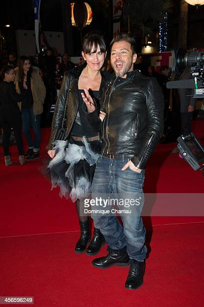 Christophe Mae and Nadege Sarron arrive at the 15th NRJ Music Awards at Palais des Festivals on December 14 2013 in Cannes France