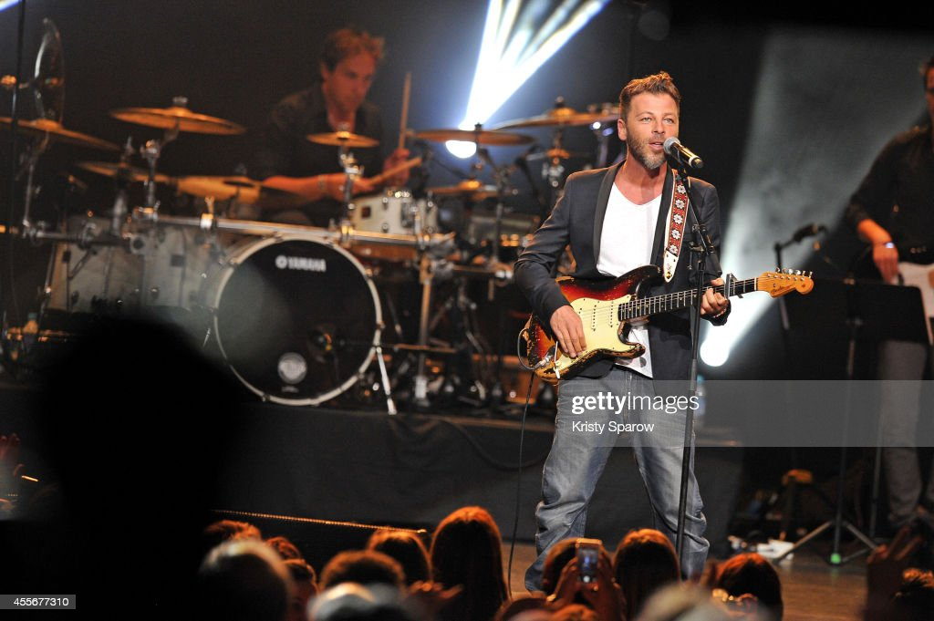 Christophe Mae performs onstage during 'Leurs Voix Pour L'Espoir 2014' concert at L'Olympia on September 18, 2014 in Paris, France.