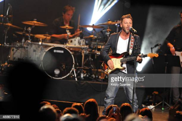 Christophe Mae performs onstage during 'Leurs Voix Pour L'Espoir 2014' concert at L'Olympia on September 18 2014 in Paris France