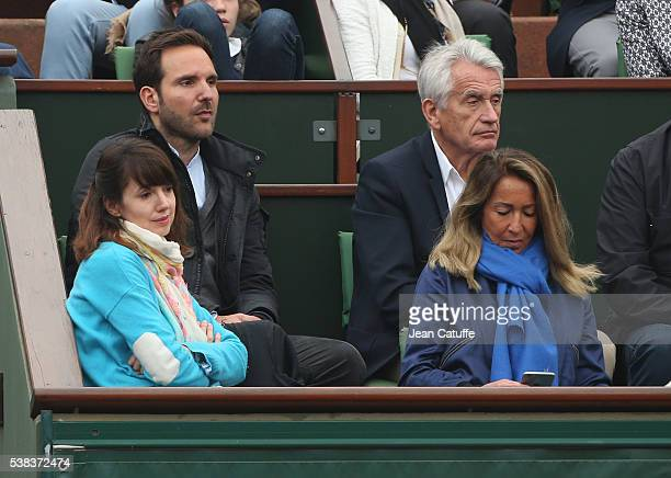 Christophe Michalak his wife Delphine McCarty Gilbert Coullier his wife Nicole Coullier attend the Men's Singles final between Novak Djokovic of...