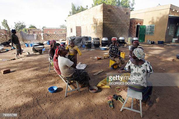 Christophe PARAYRE Burkinabe women from the Ragussi association take a break 14 January 2008 outside the organic shea butter production workshop in...