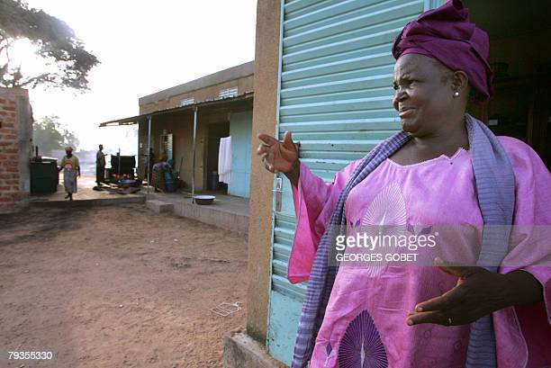 Christophe PARAYRE Henriette Ouedraogo the president of the Ragussi association speaks 14 January 2008 outside the organic shea butter production...