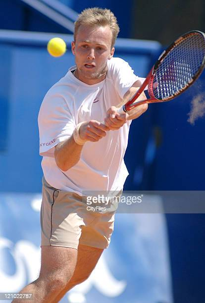 Christophe Rochus hits a backhand during a match against Gilles Muller in the first round of the Estoril Open Estoril Portugal on May 1 2006