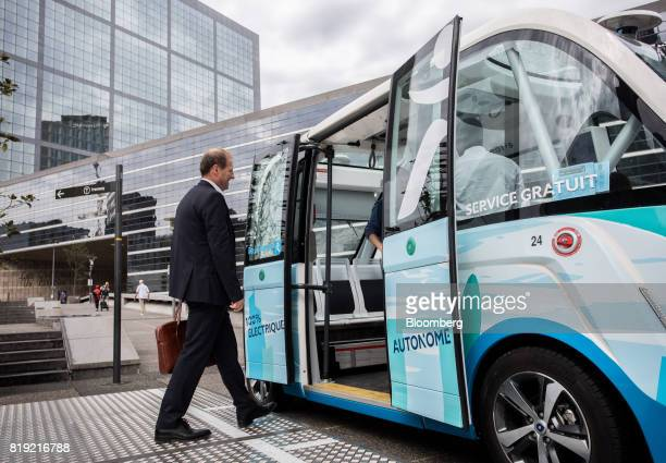 Christophe Sapet chief executive officer of Navya Technologies SAS boards an Arma autonomous shuttle bus in La Defense district of Paris France on...
