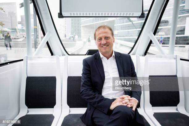 Christophe Sapet chief executive officer of Navya Technologies SAS poses for photograph inside an Arma autonomous shuttle bus in La Defense district...