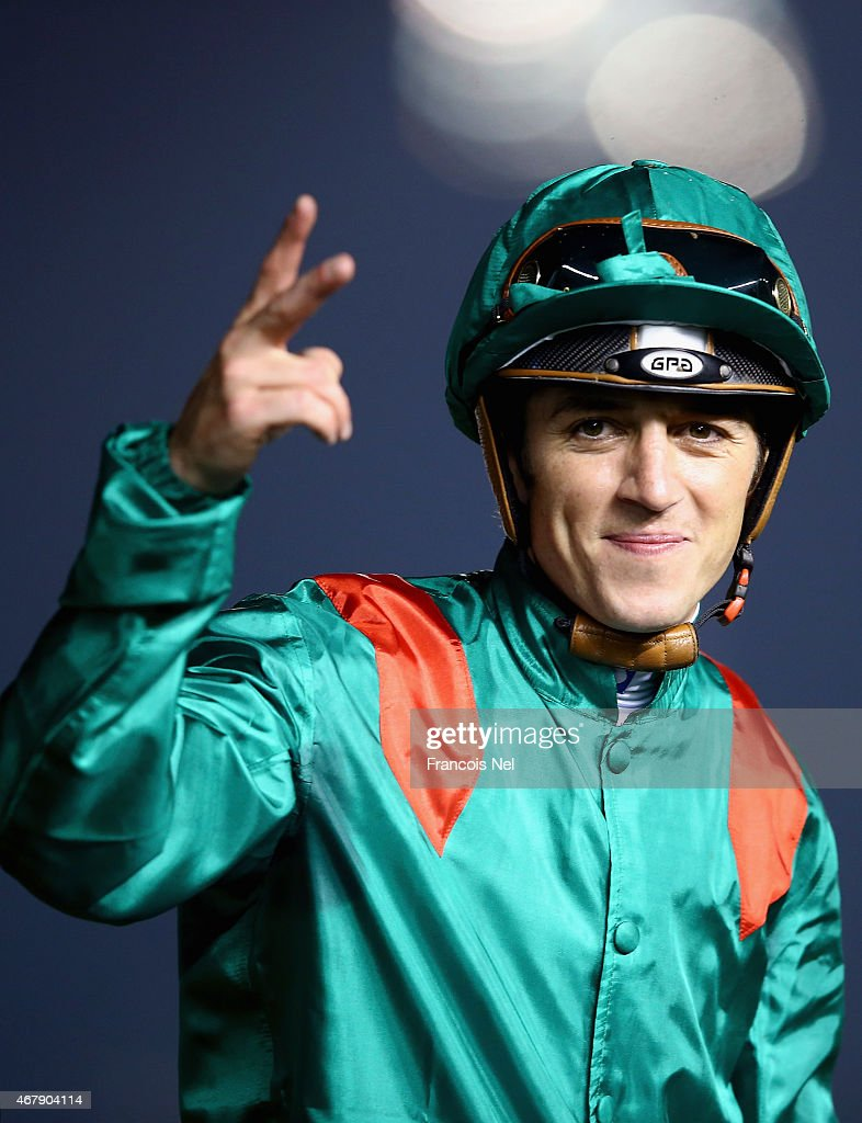 <a gi-track='captionPersonalityLinkClicked' href=/galleries/search?phrase=Christophe+Soumillon&family=editorial&specificpeople=453308 ng-click='$event.stopPropagation()'>Christophe Soumillon</a> celebrates riding Dolniya to victory during the Dubai World Cup at the Meydan Racecourse on March 28, 2015 in Dubai, United Arab Emirates.
