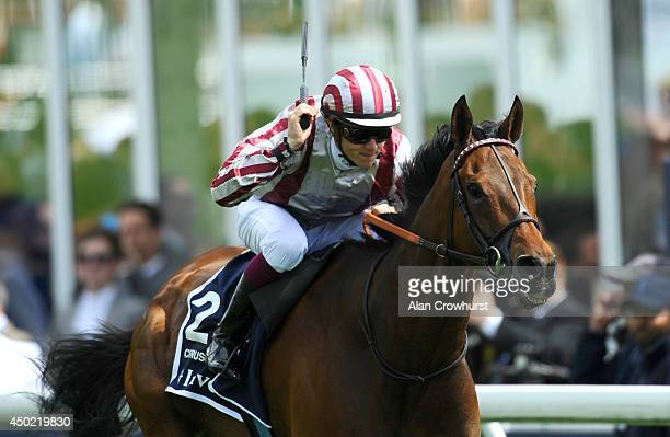 Christophe Soumillon riding Cirrus Des Aigles win The Investec Coronation Cup at Epsom racecourse on June 07 2014 in Epsom England
