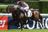Christophe Soumillon riding Cirrus Des Aigles win The Prix Ganay from Treve and Frankie Dettori at Longchamp racecourse on April 27 2014 in Paris...