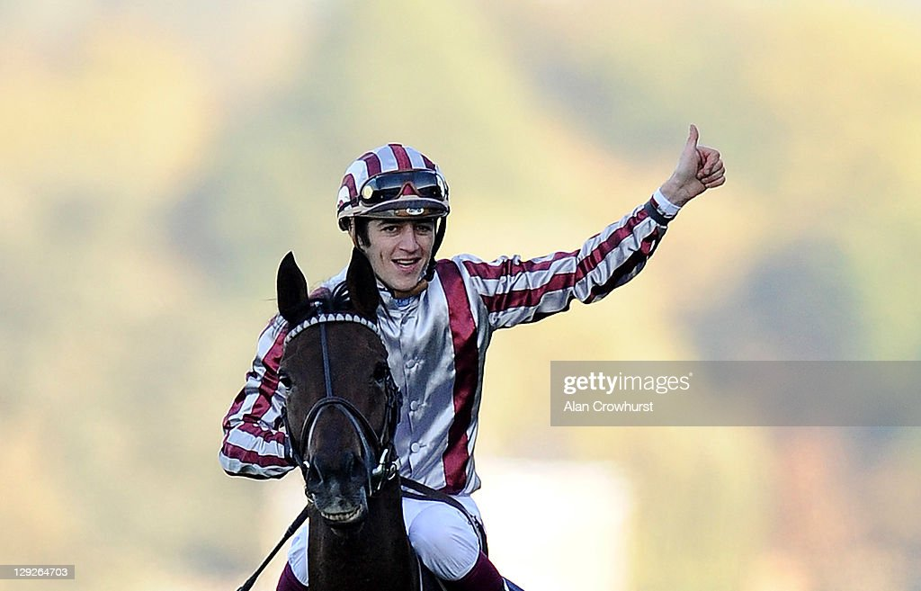 <a gi-track='captionPersonalityLinkClicked' href=/galleries/search?phrase=Christophe+Soumillon&family=editorial&specificpeople=453308 ng-click='$event.stopPropagation()'>Christophe Soumillon</a> riding Cirrus Des Aigles win The Qipco Champion Stakes at Ascot racecourse on October 15, 2011 in Ascot, England.